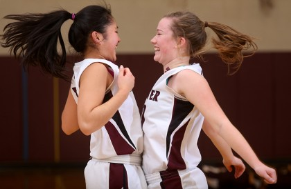 Hanover teammates Emma Riccardi, left, and Sarah Bibeau chest bump during team introductions before the start of the game against Lebanon in Hanover, N.H., on January 8, 2016. Lebanon won, 44-41. (Valley News - Geoff Hansen) Copyright © Valley News. May not be reprinted or used online without permission. Send requests to permission@vnews.com.